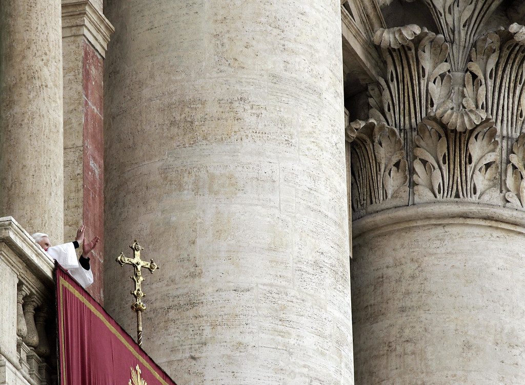 Description of . Germany's Joseph Ratzinger, the new Pope Benedict XVI, appears at the window of St Peter's Basilica's main balcony after being elected the 265th pope of the Roman Catholic Church 19 April 2005 at the Vatican City. PAOLO COCCO/AFP/Getty Images