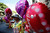 A woman sells balloons to celebrate on Valentine's Day in Caracas February 14, 2013. REUTERS/Jorge Silva