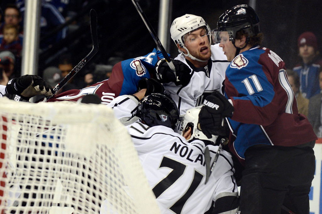 Description of . DENVER, CO. - JANUARY 22: Los Angeles Kings defenseman Jake Muzzin (6) tangles with Colorado Avalanche left wing Jamie McGinn (11) and other players behind the goal during the first period. The Colorado Avalanche hosted the Los Angeles Kings at the Pepsi Center on January, 22, 2013.   (Photo By John Leyba / The Denver Post)