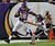 Minnesota Vikings running back Adrian Peterson (28) pushes off of Chicago Bears safety Chris Conte (47) for a 14-yard gain during the first half of their NFL football game in Minneapolis, December 9, 2012. REUTERS/Eric Miller