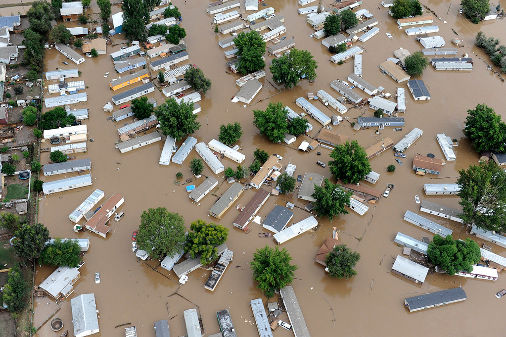 Description of . Flood water in a trailer park off of 37th street in Evans Colorado, carrying belongings recovered from flooded  homes in the area. Aerial photographs of the Platte River flooding cities and farms in Weld County Colorado. (Photo By Tim Rasmussen/The Denver Post)
