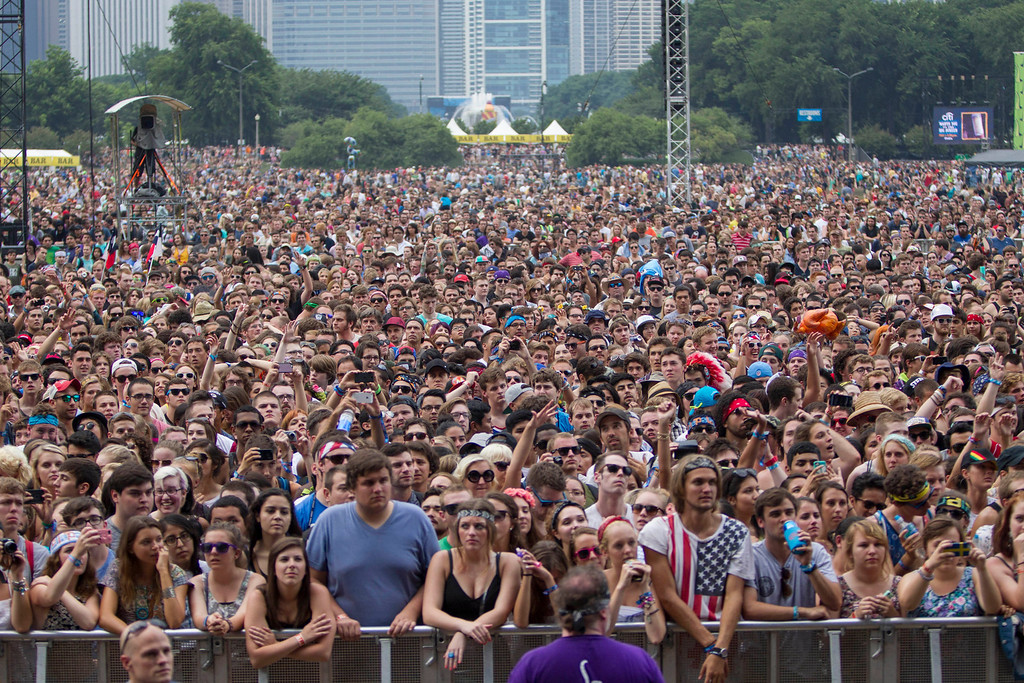 Description of . Fans at Lollapalooza Festival wait for the next act to begin in Chicago, Friday, Aug. 2, 2013.  (AP Photo/Scott Eisen)