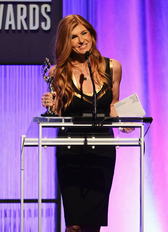 Description of . Presenter Connie Britton onstage during the 15th Annual Costume Designers Guild Awards with presenting sponsor Lacoste at The Beverly Hilton Hotel on February 19, 2013 in Beverly Hills, California.  (Photo by Jason Merritt/Getty Images for CDG)