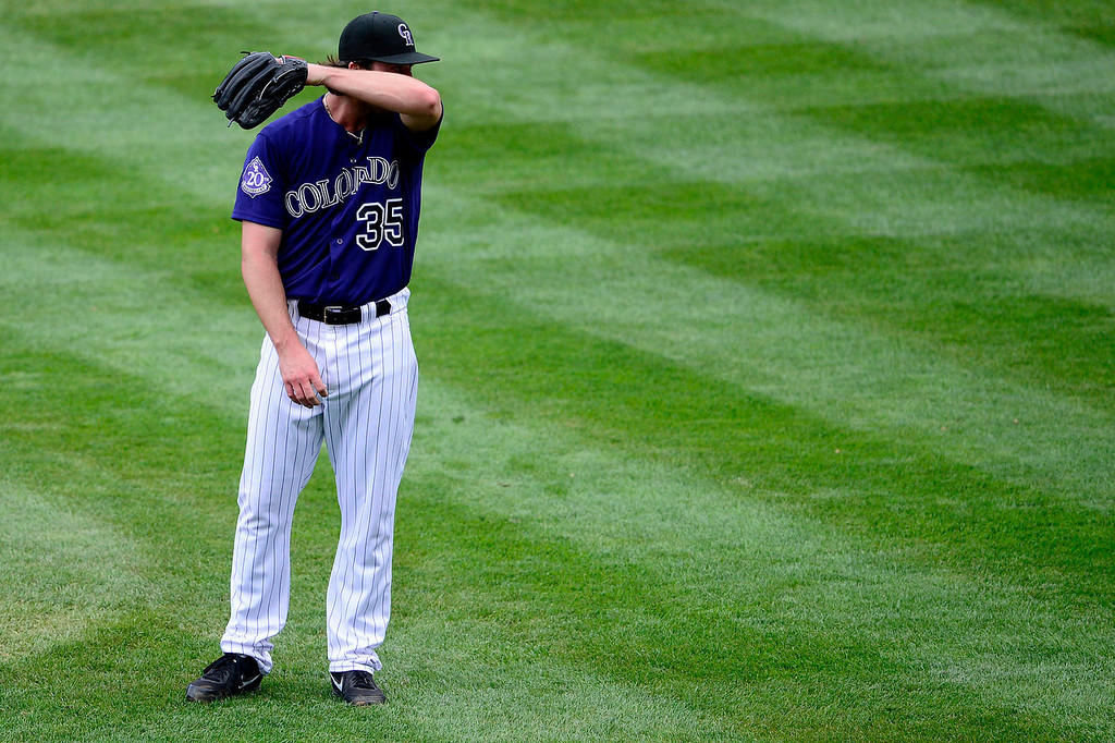 Description of . Chad Bettis (35) of the Colorado Rockies reacts to beaning Yasiel Puig (66) of the Los Angeles Dodgers during the action in Denver on Monday, September 2, 2013. The Colorado Rockies hosted the Los Angeles Dodgers at Coors Field.   (Photo by AAron Ontiveroz/The Denver Post)