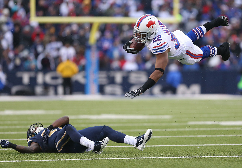 Description of . ORCHARD PARK, NY - DECEMBER 9: Fred Jackson #22 of the Buffalo Bills is sent flying on a tackle by Quintin Mikell #27 of the St. Louis Rams during an NFL game at Ralph Wilson Stadium on December 9, 2012 in Orchard Park, New York. (Photo by Tom Szczerbowski/Getty Images)