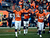 Denver Broncos wide receiver Brandon Stokley (14) celebrates his touchdown during the first quarter.  The Denver Broncos vs Baltimore Ravens AFC Divisional playoff game at Sports Authority Field Saturday January 12, 2013. (Photo by Tim Rasmussen,/The Denver Post)