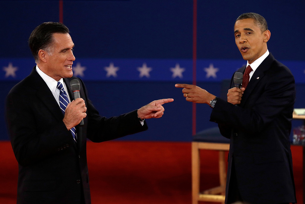 . In this Oct. 16, 2012 file photo, Republican presidential nominee Mitt Romney, left, and President Barack Obama spar during the second presidential debate at Hofstra University in Hempstead, N.Y. (AP Photo/Charlie Neibergall, File)