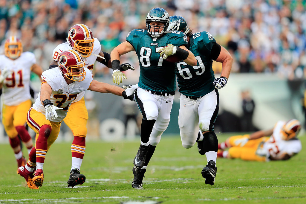 Description of . Strong safety Reed Doughty #37 of the Washington Redskins tackles tight end Brent Celek #87 of the Philadelphia Eagles after catching a second quarter pass at Lincoln Financial Field on November 17, 2013 in Philadelphia, Pennsylvania.  (Photo by Rob Carr/Getty Images)