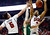UNLV's Katin Reinhardt, left, and Khem Birch, right, try to block a shot from Colorado State's Wes Eikmeier during the first half of an NCAA college basketball game Wednesday, Feb. 20, 2013, in Las Vegas. (AP Photo/Isaac Brekken)