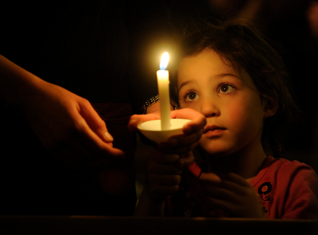 Description of . Elana Kahn, 4, and her mom Amber joined the University Park United Methodist Church in a candlelight vigil on Sat., Dec. 15, 2012 as they gather to pray and to memorialize those involved in the Connecticut school shooting. Kathryn Scott Osler, The Denver Post