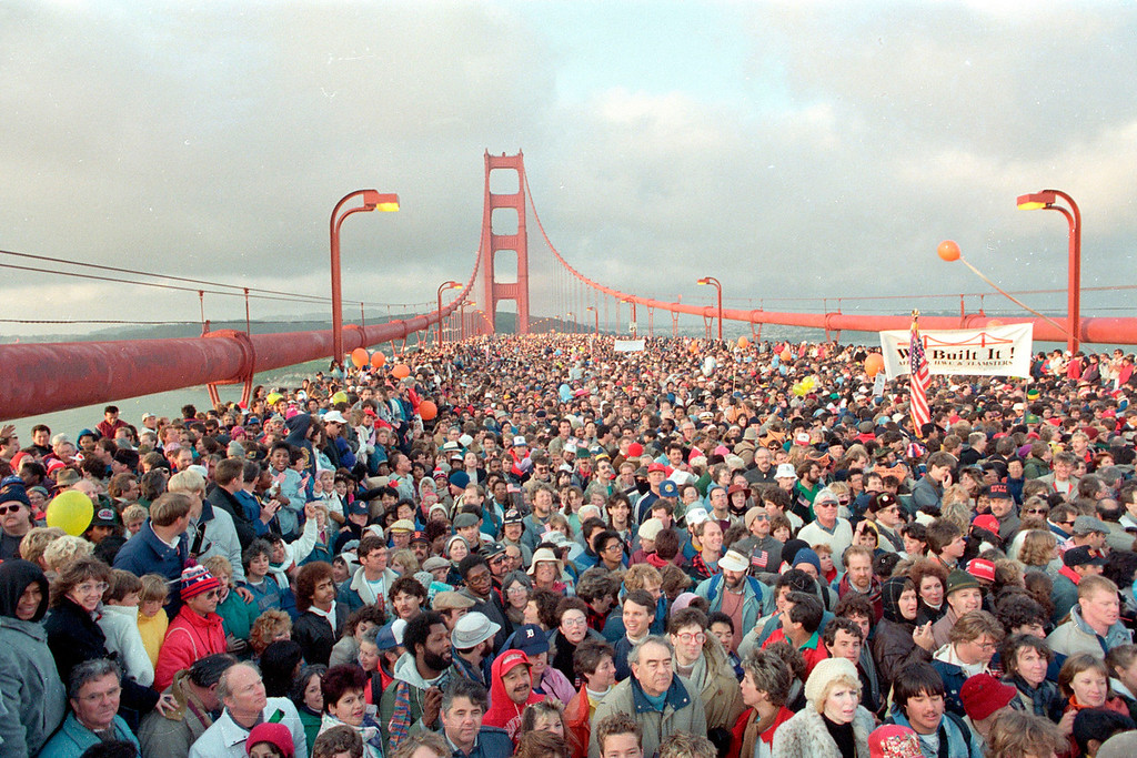 Description of . A crowd estimated at 800,000 jams the deck of the Golden Gate Bridge in San Francisco, Calif., on May 24, 1987, as a walk is kicked off to celebrate the 50th anniversary of the bridge that spans the San Francisco Bay.  (AP Photo/Paul Sakuma)