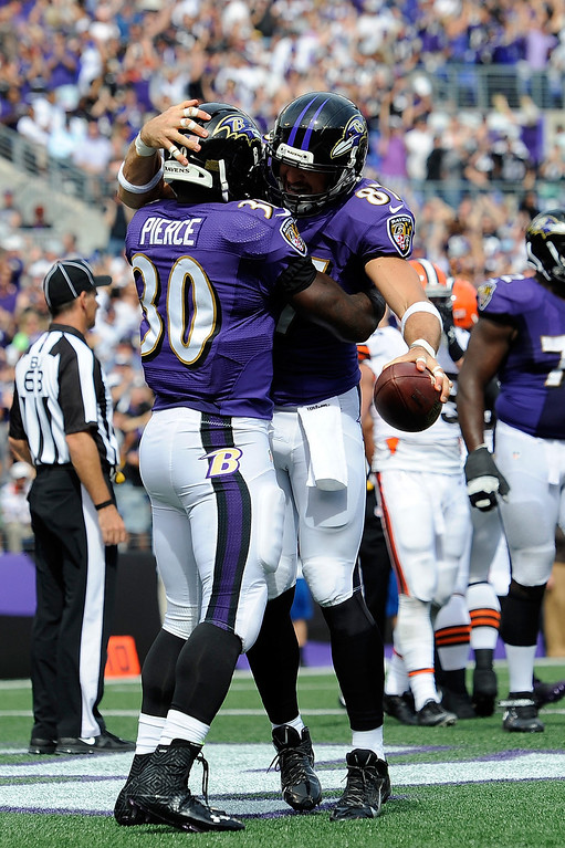 Description of . Bernard Pierce #30 of the Baltimore Ravens celebrates with Dallas Clark #87 after scoring a 5-yard touchdown in the third quarter of a game against the Cleveland Browns at M&T Bank Stadium on September 15, 2013 in Baltimore, Maryland.  (Photo by Patrick McDermott/Getty Images)