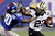 New York Giants cornerback Prince Amukamara (20) grabs New Orleans Saints running back Pierre Thomas (23) by his face mask as he tries to bring him down during the second half of an NFL football game, Sunday, Dec. 9, 2012, in East Rutherford, N.J. (AP Photo/Kathy Willens)