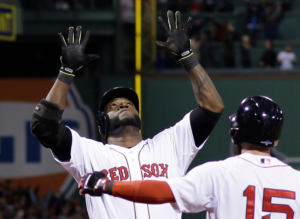 Description of . Boston Red Sox's David Ortiz celebrates with Dustin Pedroia after hitting a grand slam home run in the eighth inning during Game 2 of the American League baseball championship series against the Detroit Tigers Sunday, Oct. 13, 2013, in Boston. (AP Photo/Matt Slocum)