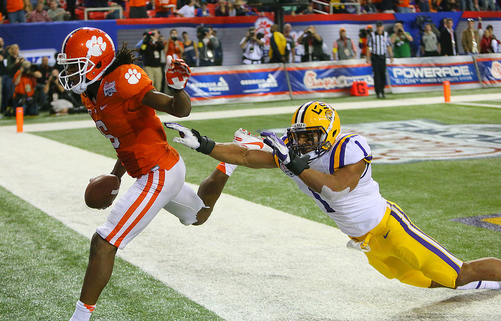 . Clemson wide receiver DeAndre Hopkins gets past LSU safety Eric Reid for a touchdown reception to cut the LSU lead to 24-22 in the fourth quarter of the Chick-fil-A NCAA college football game in Atlanta on Monday, Dec. 31, 2012. Clemson won 25-24. (AP Photo/Atlanta Journal & Constitution, Curtis Compton)