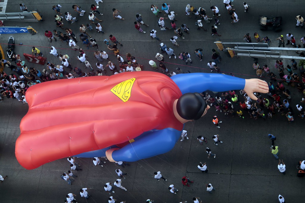 Description of . A giant balloon with the shape of Superman participates in the Christmas parade in Acapulco, Guerrero state , Mexico, on December 25, 2013. Pedro PARDO/AFP/Getty Images