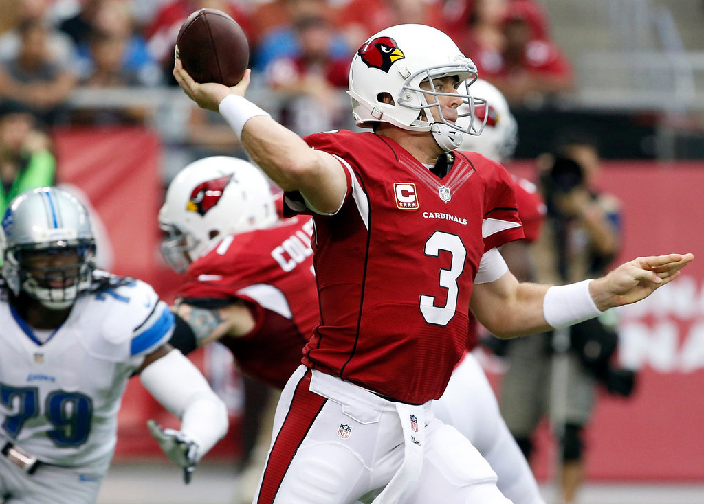 Description of . Arizona Cardinals quarterback Carson Palmer (3) drops back to throw as Detroit Lions defensive end Willie Young (79) pursues during the first half of a NFL football game, Sunday, Sept. 15, 2013, in Glendale, Ariz. (AP Photo/Darryl Webb)
