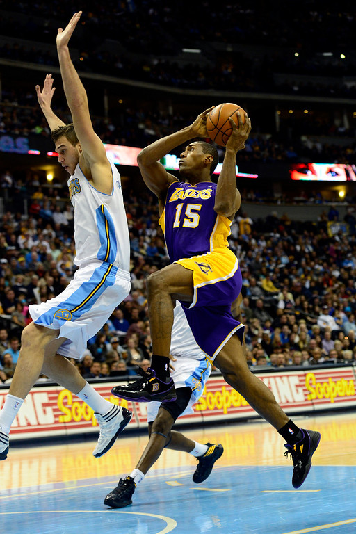 Description of . Los Angeles Lakers small forward Metta World Peace (15) drives on Denver Nuggets small forward Danilo Gallinari (8) during the second half of the Nuggets' 126-114 win at the Pepsi Center on Wednesday, December 26, 2012. AAron Ontiveroz, The Denver Post