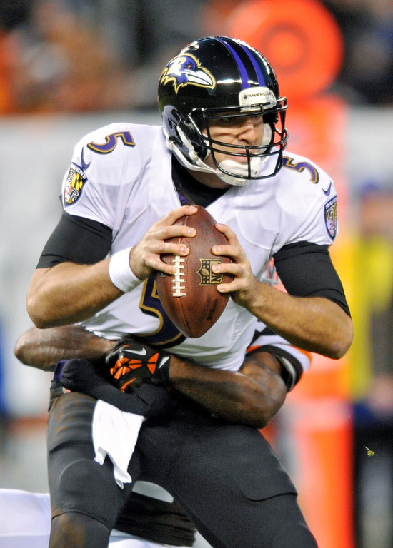 . Baltimore Ravens quarterback Joe Flacco (5) is sacked by Cleveland Browns cornerback Chris Owens in the second quarter of an NFL football game Sunday, Nov. 3, 2013. (AP Photo/David Richard)