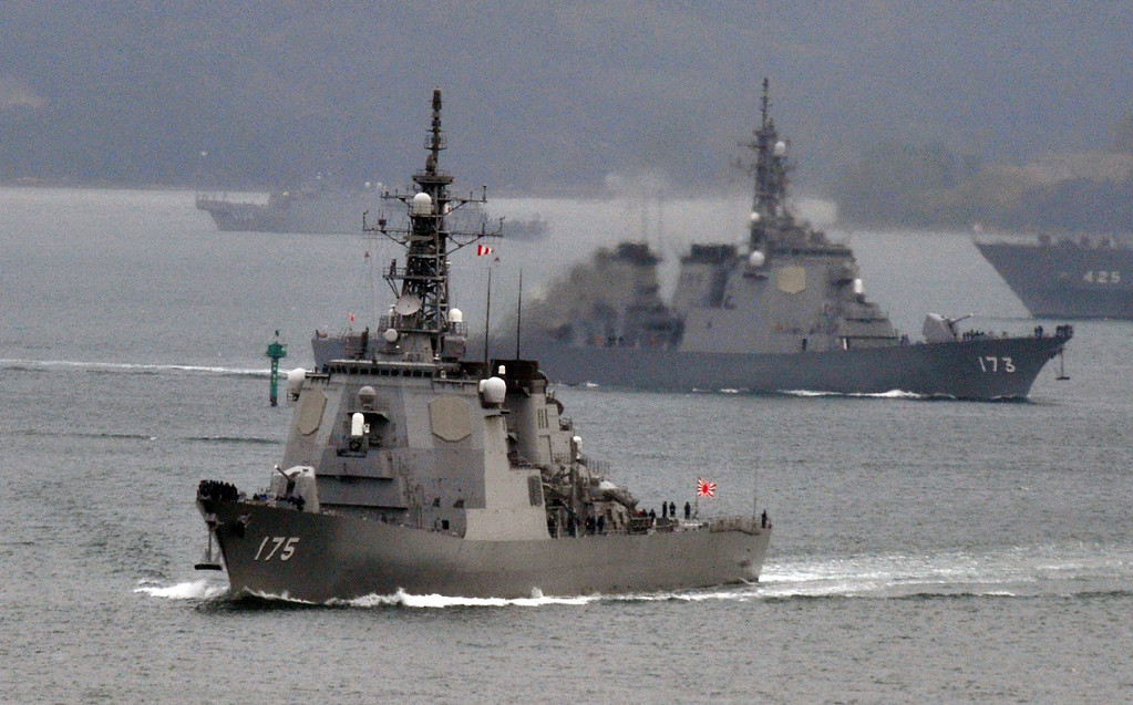 Description of . (FILES) This file photo taken on December 6, 2012 shows Japanese Maritime Defense Force\'s Aegis cruiser Myoko (L) and Kongo (R) leaving the Sasebo naval base in Nagasaki prefecture. The Japanese government said on December 12, 2012 North Korea\'s missile passed over its southern island chain of Okinawa around 12 minutes after take-off. North Korea carried out on December 12, 2012 a widely criticised rocket launch, seen by many in the international community as a disguised ballistic missile test, the South Korean defence ministry said.     JIJI PRESS/AFP/Getty Images