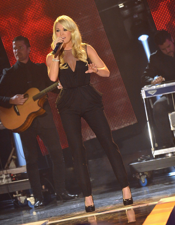 Description of . Carrie Underwood performs onstage during the 2012 CMT Artists Of The Year at The Factory at Franklin on December 3, 2012 in Franklin, Tennessee.  (Photo by Rick Diamond/Getty Images for CMT)