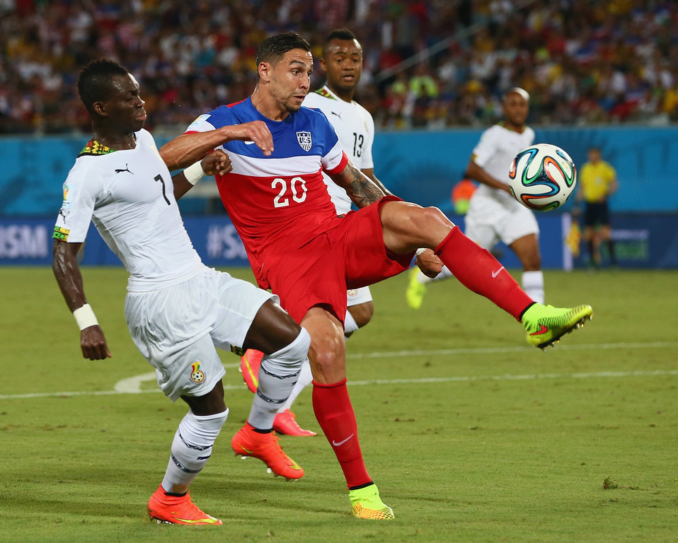 Description of . Geoff Cameron of the United States competes for the ball with Christian Atsu of Ghana during the 2014 FIFA World Cup Brazil Group G match between Ghana and the United States at Estadio das Dunas on June 16, 2014 in Natal, Brazil.  (Photo by Kevin C. Cox/Getty Images)