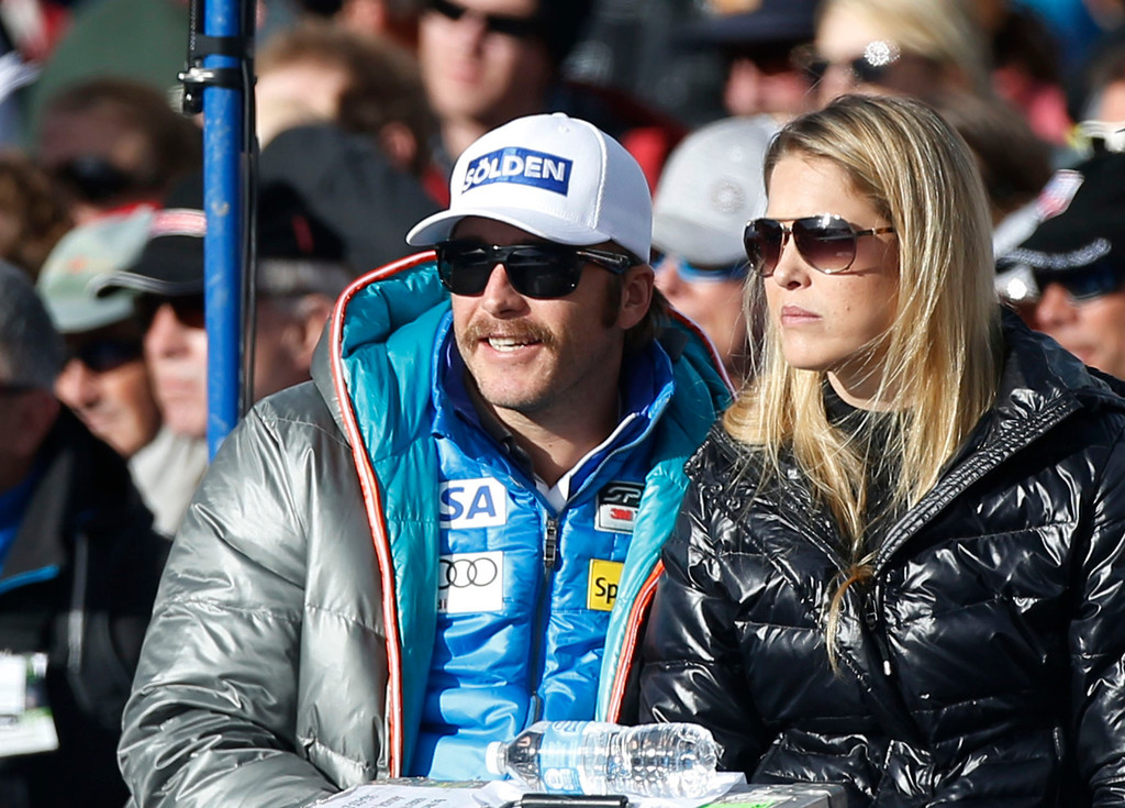 Description of . Bode Miller, U.S. alpine World Cup ski racer, watches the men's World Cup downhill ski race with his wife Morgan Beck in Beaver Creek, Colorado November 30, 2012. Miller is recovering from knee surgery and is not competing. REUTERS/Rick Wilking