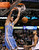 Denver Nuggets forward Danilo Gallinari dunks the ball as Dallas Mavericks center Brandan Wright watches during the second half of their NBA basketball game in Dallas, Texas December 28, 2012.  REUTERS/Mike Stone (UNITED STATES - Tags: SPORT BASKETBALL)