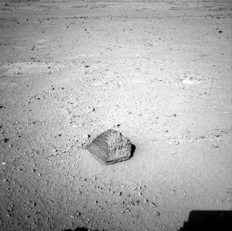 Description of . FILE - This Wednesday, Sept. 19, 2012 photo provided by NASA shows a rock about 8 feet (2.5 meters) in front of the Curiosity rover on Mars. The rock is about 10 inches (25 centimeters) tall and 16 inches (40 centimeters) wide. The team has assessed it as a suitable target for the first use of Curiosity's contact instruments on a rock, and named it after the late Jacob Matijevic, who was the surface operations systems chief engineer for the Mars Science Laboratory Project and the project's Curiosity rover. (AP Photo/NASA/JPL-Caltech)