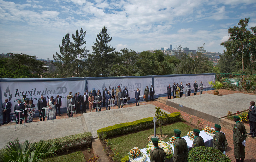 Description of . Dignitaries prepare to lay memorial wreaths on stone-topped vaults containing the remains of around 250,000 victims of the genocide, at a ceremony to mark the 20th anniversary of the Rwandan genocide, held at the Kigali Genocide Memorial Center in Kigali, Rwanda Monday, April 7, 2014.  (AP Photo/Ben Curtis)