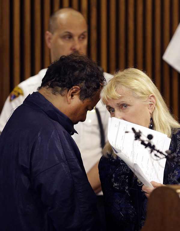 Description of . Ariel Castro appears in Cleveland Municipal court Thursday, May 9, 2013, in Cleveland. Castro was charged with four counts of kidnapping and three counts of rape.  Ariel Castro was charged while his brothers, Pedro and Onil Castro, were held but faced no immediate charges. (AP Photo/David Duprey)