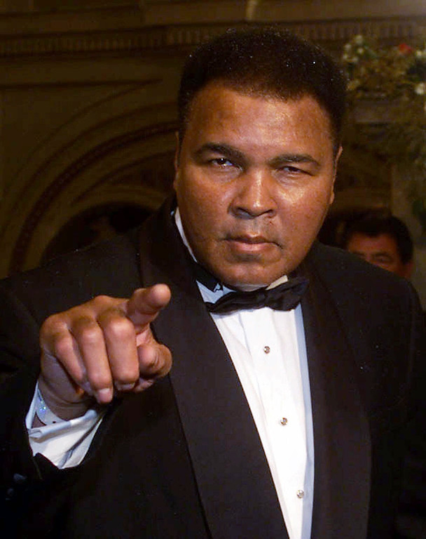 Description of . Former boxing champion Muhammad Ali points to the photographers upon his arrival , Friday, Nov. 19 1999 for the World Sports Award of the Century Gala at the state opera in Vienna. During the Gala Evening eleven winners will be named in the following disciplines: athletics, ball sports, soccer, contact sports, motor sport, water sports and winter sports. (AP Photo/Martin Gnedt)