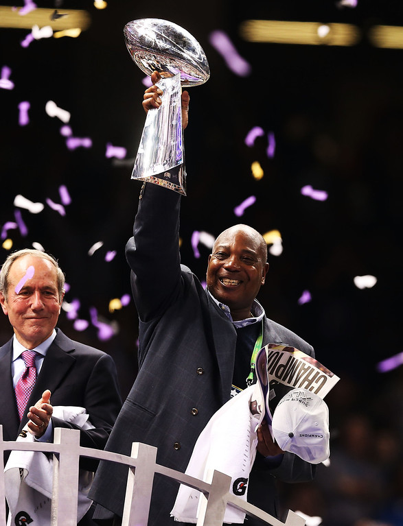 Description of . General manager Ozzie Newsome of the Baltimore Ravens celebrates with the Vince Lombardi trophy after the Ravens won 34-31 against the San Francisco 49ers during Super Bowl XLVII at the Mercedes-Benz Superdome on February 3, 2013 in New Orleans, Louisiana.  (Photo by Christian Petersen/Getty Images)