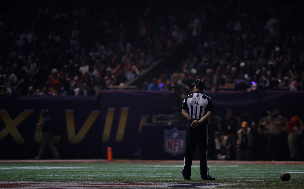 Description of . Field judge Craig Wrolstad stands on the field after the lights went out during the second half of NFL Super Bowl XLVII football game Sunday, Feb. 3, 2013, in New Orleans. (AP Photo/Matt Slocum)