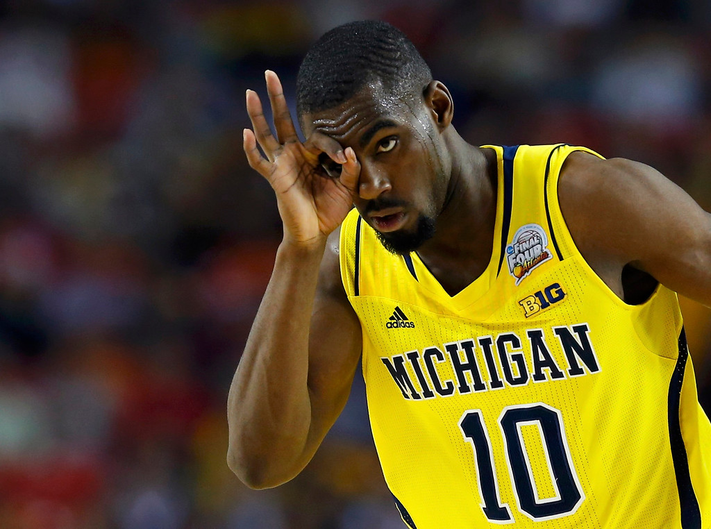 Description of . Michigan Wolverines guard Tim Hardaway Jr. reacts after making a three point basket against the Syracuse Orange during the second half of their NCAA men's Final Four basketball game in Atlanta, Georgia April 6, 2013. REUTERS/Chris Keane