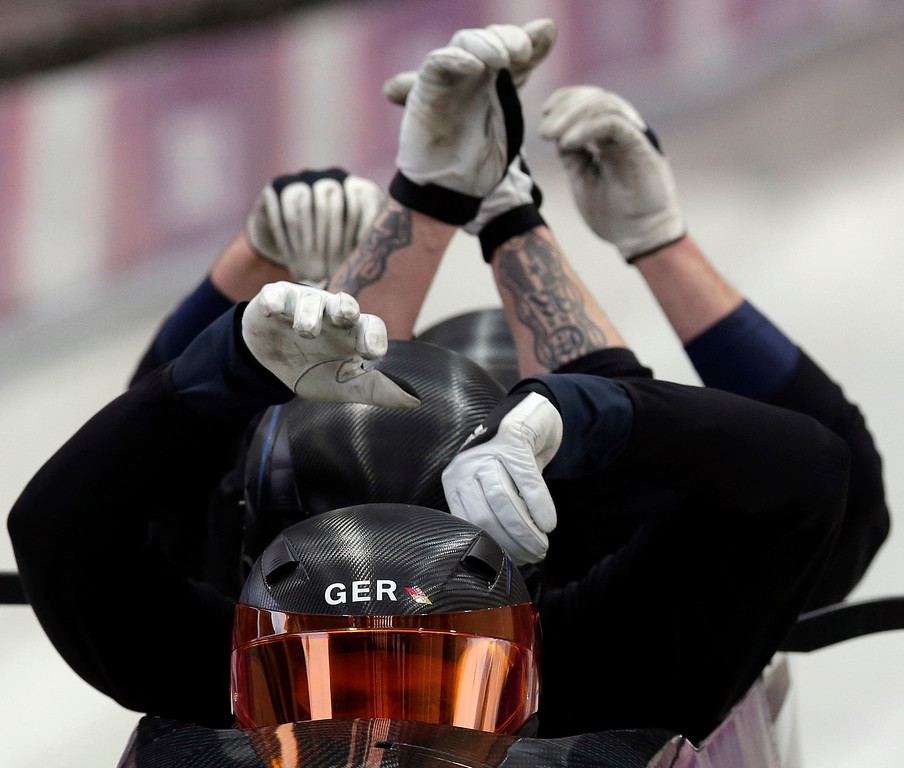 Description of . The team from Germany GER-1, piloted by Maximilian Arndt, start a run during the men's four-man bobsled training at the 2014 Winter Olympics, Thursday, Feb. 20, 2014, in Krasnaya Polyana, Russia. (AP Photo/Michael Sohn)
