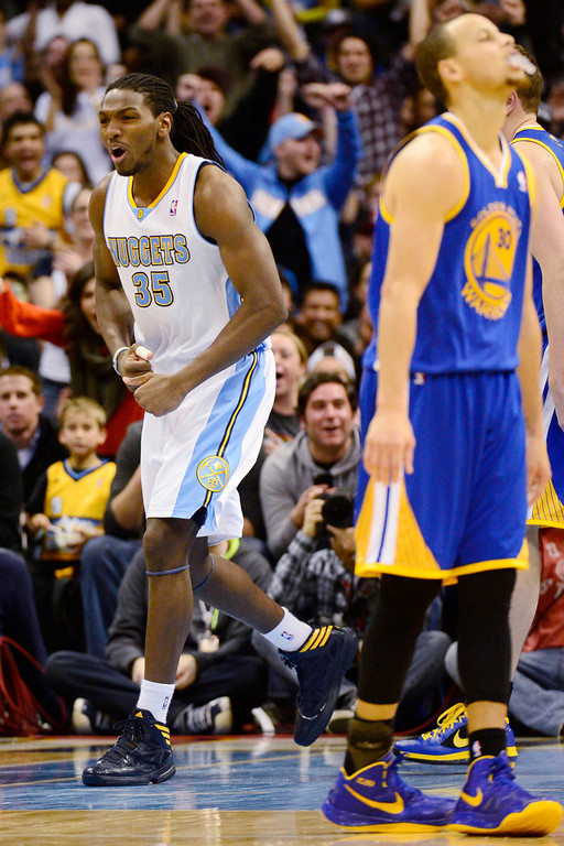 Description of . Denver Nuggets small forward Kenneth Faried (35) reacts to a dunk and a foul against the Golden State Warriors during the second half of the Nuggets' 116-105 win at the Pepsi Center on Sunday, January 13, 2013. AAron Ontiveroz, The Denver Post