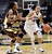 Colorado's Arielle Roberson, right, drives past Wyoming's Chaudra Sewell during their NCAA college basketball game, Wednesday, Nov. 28, 2012, in Boulder, Colo. (AP Photo/The Daily Camera, Jeremy Papasso)