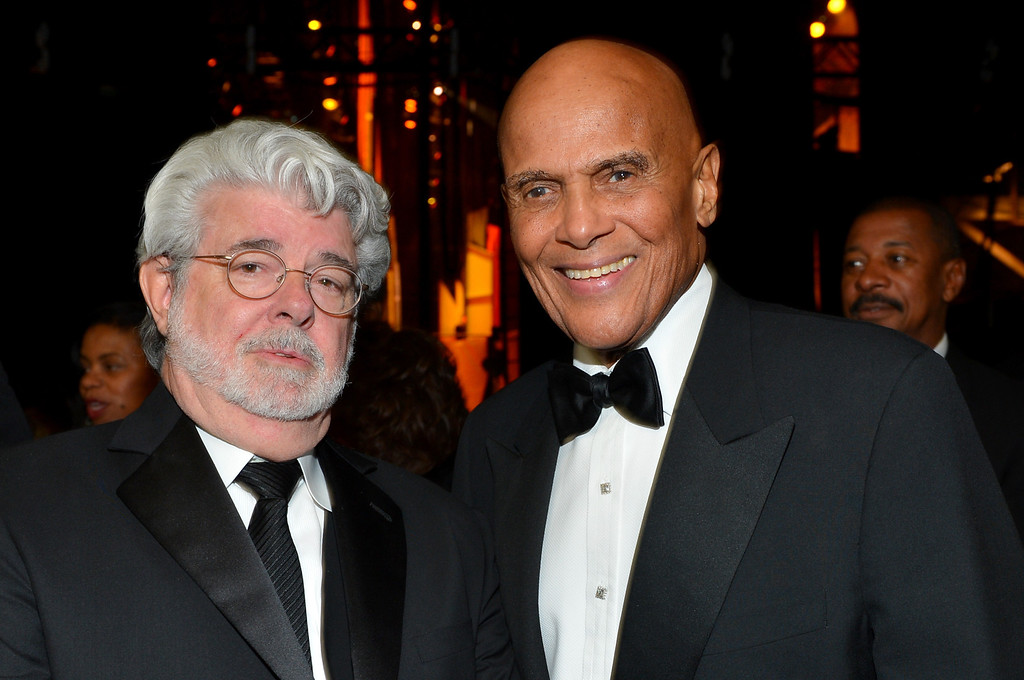 Description of . LOS ANGELES, CA - FEBRUARY 01:  Producer George Lucas (L) and honoree Harry Belafonte attend the 44th NAACP Image Awards at The Shrine Auditorium on February 1, 2013 in Los Angeles, California.  (Photo by Alberto E. Rodriguez/Getty Images for NAACP Image Awards)