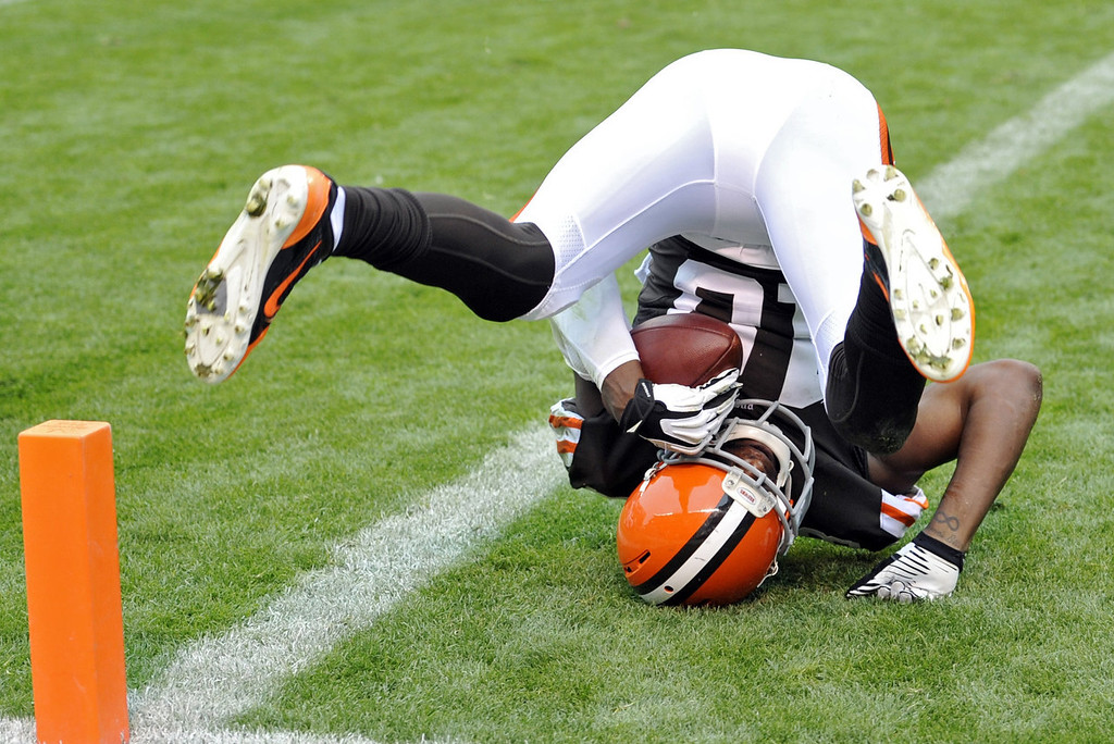 Description of . Cleveland Browns wide receiver Greg Little lands in the end zone after a 2-yard touchdown catch in the second quarter of an NFL football game against the Detroit Lions Sunday, Oct. 13, 2013 in Cleveland. (AP Photo/David Richard)