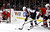 Chicago Blackhawks center Jonathan Toews (19) keeps Colorado Avalanche left wing Jamie McGinn from getting a shot on Blackhawks goalie Ray Emery (30) during the first period of an NHL hockey game, Wednesday, March 6, 2013, in Chicago. (AP Photo/Charles Rex Arbogast)