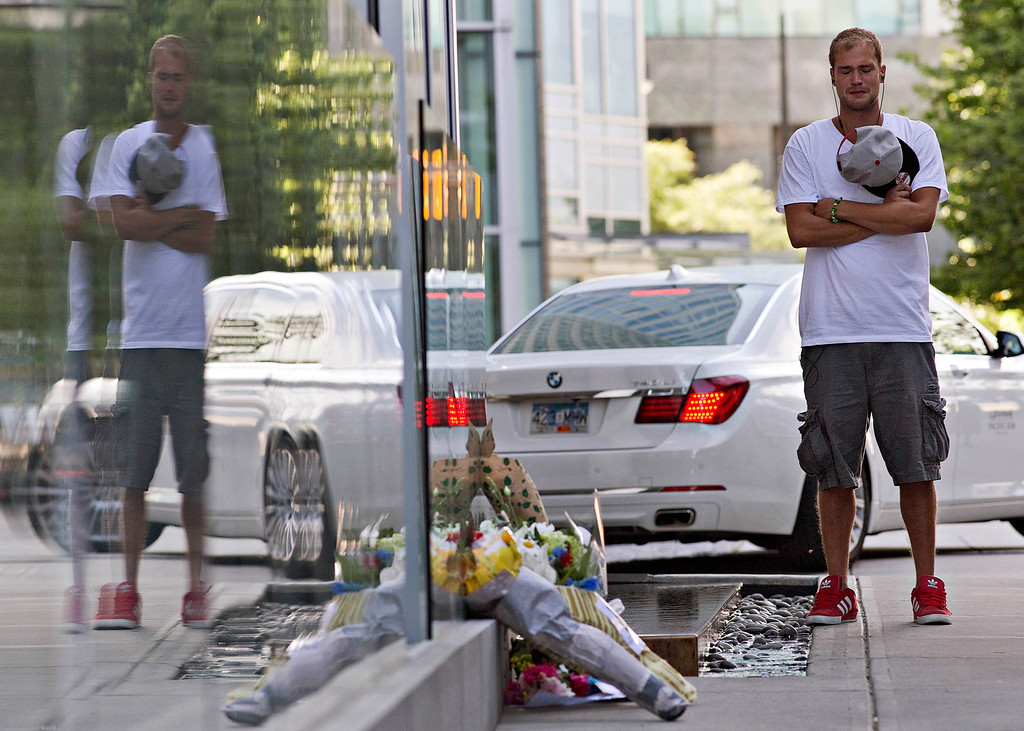 Description of . Richard Monteith, cousin of Canadian actor Cory Monteith, pauses at a small memorial outside a downtown hotel in Vancouver, British Columbia July 14, 2013. Cory Monteith, 31-year-old heartthrob of Fox's musical comedy television series