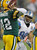 Detroit Lions' Ndamukong Suh (90) rushes Green Bay Packers quarterback Aaron Rodgers (12) during the second half of an NFL football game Sunday, Dec. 9, 2012, in Green Bay, Wis. (AP Photo/Mike Roemer)