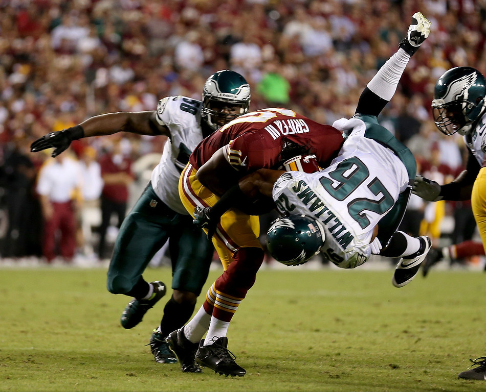Description of . Cornerback Cary Williams #26 of the Philadelphia Eagles sacks quarterback Robert Griffin III #10 of the Washington Redskins in the second quarter at FedExField on September 9, 2013 in Landover, Maryland.  (Photo by Rob Carr/Getty Images)