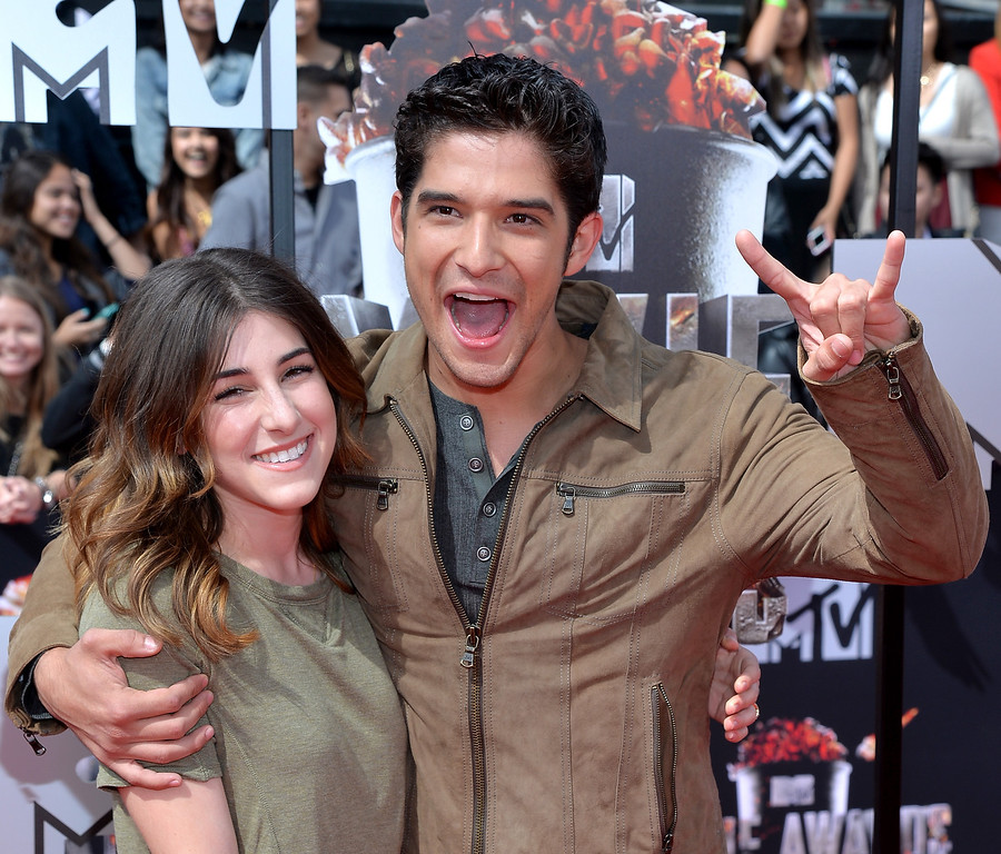 Description of . Actor Tyler Posey (R) and Seana Gorlick attend the 2014 MTV Movie Awards at Nokia Theatre L.A. Live on April 13, 2014 in Los Angeles, California.  (Photo by Michael Buckner/Getty Images)