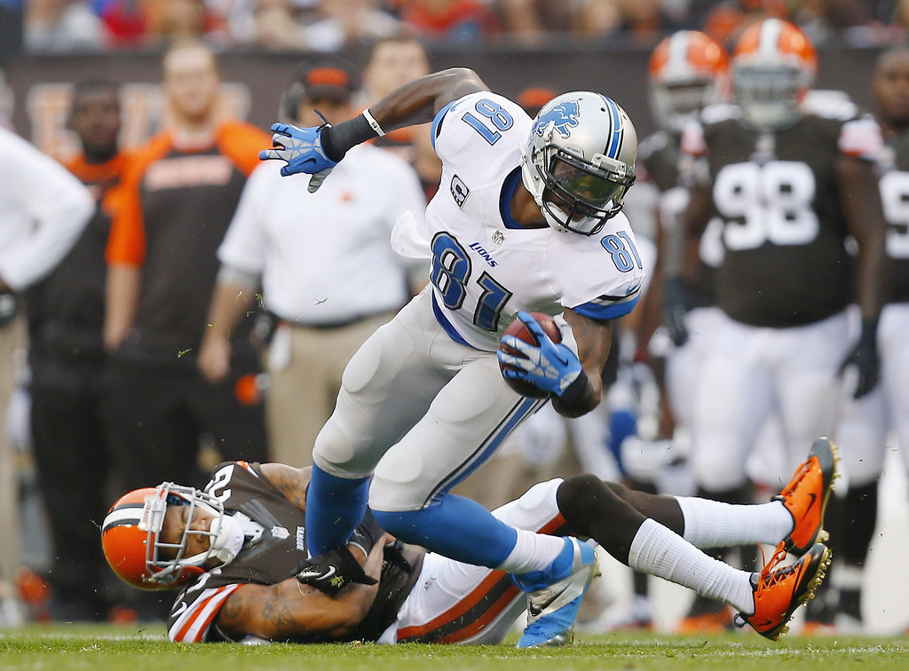 Description of . Wide receiver Calvin Johnson #81 of the Detroit Lions is hit by defensive back Joe Haden #23 of the Cleveland Browns at FirstEnergy Stadium on October 13, 2013 in Cleveland, Ohio.  (Photo by Matt Sullivan/Getty Images)
