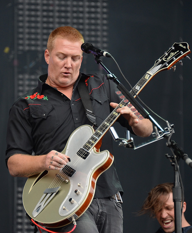 Description of . CHICAGO, IL - AUGUST 02:  Josh Homme of Queens of the Stone Age performs during Lollapalooza 2013 at Grant Park on August 2, 2013 in Chicago, Illinois.  (Photo by Theo Wargo/Getty Images)