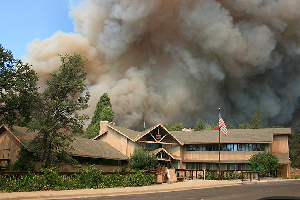 Description of . In this undated photo provided by the U.S. Forest Service, the Rim Fire burns near Groveland Ranger Station in Groveland, Calif. The wildfire outside Yosemite National Park, one of more than 50 major brush blazes burning across the western U.S., more than tripled in size overnight and still threatens about 2,500 homes, hotels and camp buildings. Fire officials said the blaze burning in remote, steep terrain had grown to more than 84 square miles and was only 2 percent contained on Thursday, down from 5 percent a day earlier. (AP Photo/U.S. Forest Service)