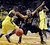 Johnathan Loyd #10 of the Oregon Ducks knocks the ball away from Spencer Dinwiddie #25 of the Colorado Buffaloes in the first half of the game  at Matthew Knight Arena on February 7, 2013 in Eugene, Oregon. (Photo by Steve Dykes/Getty Images)