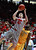 New Mexico's Cameron Bairstow shoots with Wyoming's Leonard Wahington behind him during the first half of an NCAA college basketball game in Albuquerque, N.M., Saturday, March 2, 2013. (AP Photo/Craig Fritz)
